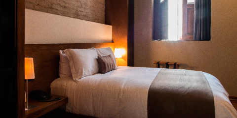 Armchair living junior suite Hotel Boutique Casa Madero